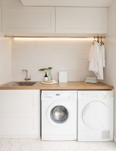 Laundry Room Ideas Discover This stylish laundry will make you want to do the washing With its herringbone oak benchtop white hexagon tiles and bagged-brick splashback this laundry is anything but ordinary. Take a look here Laundry Decor, Laundry Room Organization, Laundry Room Design, Laundry In Bathroom, Organization Ideas, Laundry Room Small, Laundry Storage, Laundry Cupboard, Cupboard Doors