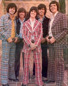 Leisure Suit: unstructured tops with shirt like collars or were collarless. It was out of style by the end of the 1970s.