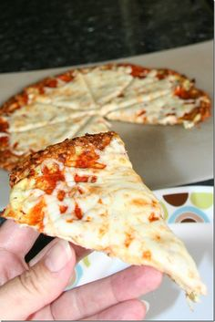 Cauliflower Crust Pizza    This cauliflower crust is firm, with great flavor, you can cut it like a regular pizza and pick up the slices and eat them with your hands.