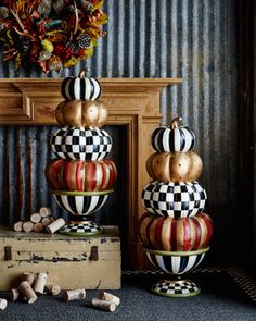 """Painted resin pumpkin topiary. 16""""Dia. x 38""""T. Imported."""