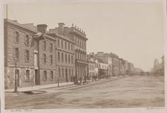 Elizabeth St, #Melbourne, west side, looking north from Flinders Street, c.1870. At corner is Hobsons Bay Railway Terminus Hotel, built as a bond store in 1854, to become Hosie's Hotel in 1885. 3 storey building is Fire & Life Insurance Company headquarters, built 1850s, demolished 1920s, site of McDonalds today. Photo: Charles Nettleton.