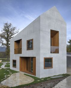 Love the wood paneled, recessed entry and window areas - Two in One House / Clavienrossier Architectes