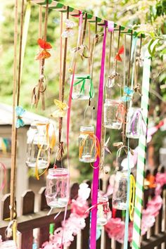 Whether for a backyard wedding or just to make your space more interesting for an outdoor party, hanging Mason jars filled with tea lights from colorful ribbons will add some whimsy. Hippie Party, Jar Of Hearts, Fashion Bubbles, Hanging Mason Jars, Hanging Candles, Deco Nature, Photo Booth Backdrop, Backdrop Ideas, Partys