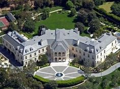 Aaron Spelling  Candy Spelling now lives by herself in this incredible hotel-sized mansion, which has 123 rooms, a bowling alley and a single room devoted entirely to gift wrapping. Aaron tore down Bing Crosby's old digs to build this colossal castle.