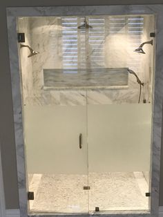 Steam shower with large shampoo niche, two shower heads, rain head and a handheld, privacy frameless glass in Plano TX
