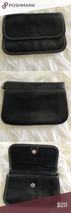 Fossil coin pouch Cute little fossil coin pouch. Black with white stitching. Fold over front with snap closure. Open pocket on back. Inside has one zipper pocket and two pouches. One small hole above snap closure not seen when closed. Height 3 1/4, width 5 1/4. Fossil Bags Wallets
