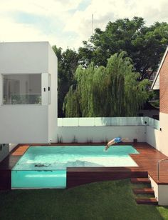 This is probably one of the nicest above ground swimming pools out there. Located in Argentina, this modern home by Andrés Remy Arquitectos features an elevated glass swimming pool design. The architects decided to raise the swimming pool because it would