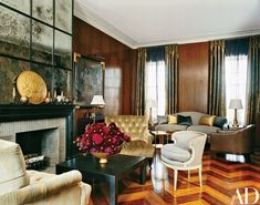 Antiqued mirror sheathes the fireplace wall in the main living room