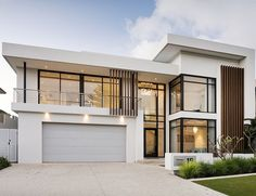 This stunning contemporary two-storey home has been shaped to fit the contours of a sloping block, harness ocean views, create a north-facing backyard sanctuary for year-round enjoyment and deliver well-zoned accommodation for a family of five. Modern Architecture House, Modern House Design, Custom Home Builders, Custom Homes, Residential Architect, Storey Homes, Dream House Exterior, Facade House, Exterior Design