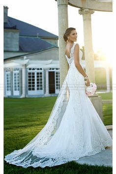 For traditional beauty, this lace bridal gown makes the cut. It features a romantic lace overlay train, which can be removed to reveal an elegant Dolce Satin under dress with sweetheart neckline and s