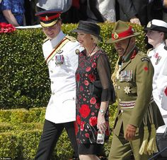 Prince Harry, New Zealand's Governor General Jerry Mateparae and his wife Janine arrive to attend a ceremony at the World War II Commomwealt...