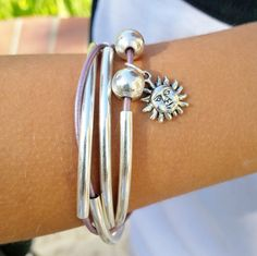 Mini Friendship Wrap with sun charm shown in Metallic Lilac Leather, comes as shown. Designed to be worn as a bracelet only.