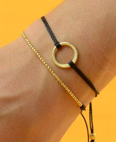 love the large eternity circle bracelet with the tiny vermeil bead bracelet