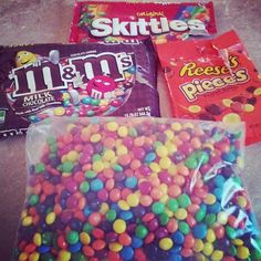 Mix Skittles and Reese's Pieces into bowls of M&Ms