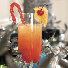 Jingle Juice:5 cups orange juice    1 cup vodka 1/3 cup orange liqueur 1/4 cup fresh lemon juice 1/2 cup maraschino cherry juice Garnishes: fruit-flavored candy cane sticks, cherries with stems, orange and lemon slices