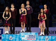 ISU World Figure Skating Championships 2016 - Day 4 Ice Dance Gold Medalists Gabriella Papadakis and Guillaume Cizeron of France (C) sing their national anthem as silver medalists Maia Shibutani and Alex Shibutani of the United States (L) and bronze medalists Madison Chock and Evan Bates of the United States look on during the medal ceremony at the ISU World Figure Skating Championships at TD Garden in Boston, Massachusetts, March 31, 2016. / AFP / Geoff Robins