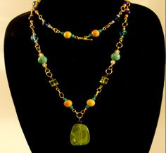 Extra Long (28 inches) Gold Circle, Green, Blue and Orange Beaded Necklace. $28.99  Made-to-order options available!