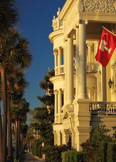 """Porcher-Simonds House, East Battery, Charleston. Note the red field on the state flag (instead of blue). The flag known as """"Big Red"""" used by The Citadel."""