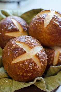 Pretzel Rolls. Made with water, instant yeast, flour, butter, sugar, salt, baking soda, egg, and kosher salt.