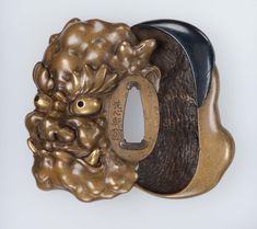 Tsuba in the form of an okame and an oni mask | MFA for Educators