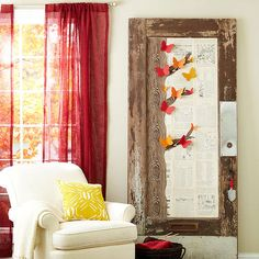 """Whimsical butterflies rest upon a graphic tree in this woodland scene on a vintage door. Use double-stick tape to tile the door's inset panel with old book pages. Cut several pages of scrapbook paper with a faux bois (false wood) motif into a tree shape. If you're uncomfortable cutting freehand, snap a photo of a tree, then enlarge, print, and trace it (or search for """"tree images"""" online). Adhere the tree shapes to the book pages using double-stick tape. Sketch, then cut out butterflies…"""