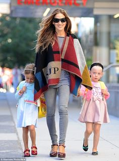 Busy mom: Sarah was seen looking the height of style as she took her daughters Tabitha and...