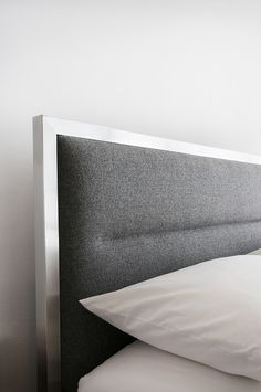 Gus* Modern | The Midway Bed features an upholstered headboard and a stainless steel perimeter frame. A horizontal channel-stitch detail in the headboard emphasizes the clean, modern lines of this design.