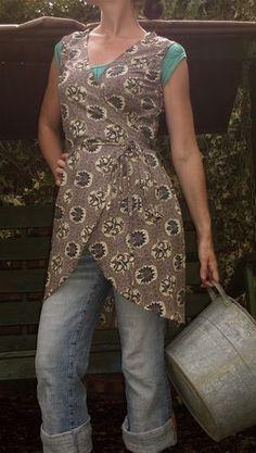 wrap apron worn over jeans, by Susannah Dashwood