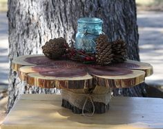 This large tree stump serving piece is perfect for a Texas-style rustic, woodland or barn themed wedding. Use for a cake, cupcakes, grooms cake or to add height to your dessert bar. Item # 103116.2  A slice of Texas Red Cedar, measuring approximately 17 at the widest and 12 at the narrowest (with a thickness of 1.75) makes the stunning top. The cedar has been planed and repeatedly sanded by hand to ensure the smoothest finish possible. The entire piece has been coated with Helmsman brand…