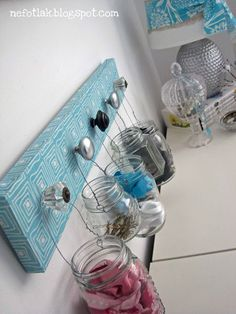 Old knobs on any type of wood and wire on mason jars for bobby pins,hair ties,q-tips, Cotten balls etc.