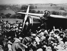 May 21, 1932. Amelia Earhart posing on fuselage of her Lockheed 5B Vega amidst a crowd of people at Culmore, North Ireland after her historic solo flight across the Atlantic from Harbour Grace, Newfoundland.