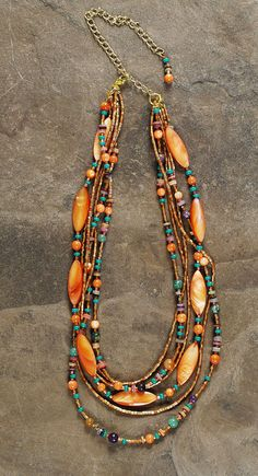 Desert Sunset Orange, Copper, Gold, Turquoise & Purple stones and beads in a Six Strand Necklace. $50.00, via Etsy.