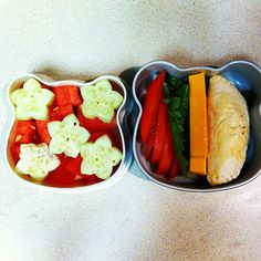 bento with cucumber and watermelon stars, tomatoes, lettuce, cheese, empanada