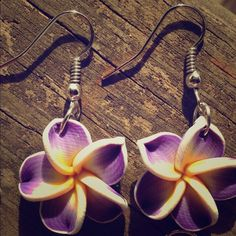 Adorable Hawaiian plumeria flower earrings Here are some brand new earrings! They are made of clay. At roughly the size of a penny, these earrings are small and dainty Jewelry Earrings