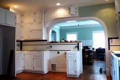 1930s reproduction kitchen with flat panel / Shaker style doors & subway tile with black accents.
