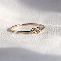 SOLID 14k White Yellow or Rose Gold Tiny Infinity Knot Ring - Knotted Thread of Gold Stacking Ring - Delicate Memory Ring by MARYJOHN on Etsy https://www.etsy.com/listing/169448582/solid-14k-white-yellow-or-rose-gold-tiny