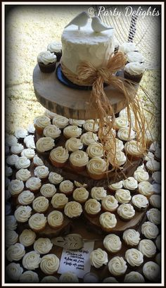 Rustic wedding cake and cupcakes on stump tower