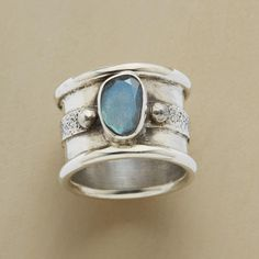 """NORTHERN LIGHTS RING--Flanked by silver beads, a faceted oval of iridescent labradorite floats flat side up on a wide sterling silver band, brushed along the middle. Exclusive. Whole sizes 5 to 9. 5/8""""W."""