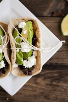 Spiced black bean, avocado, and goat cheese tacos.