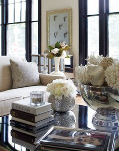 Beautiful Living room with lovely styled accessories on the coffee table.