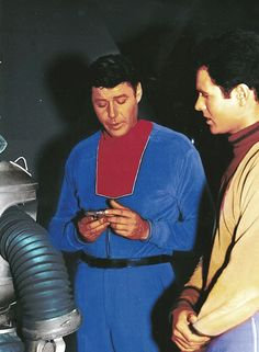 A colorized, behind the scenes image from the first season of the 1960's Irwin Allen television series, LOST IN SPACE.