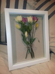 My engagement/getting a puppy flowers....dried and saved in a shadow box