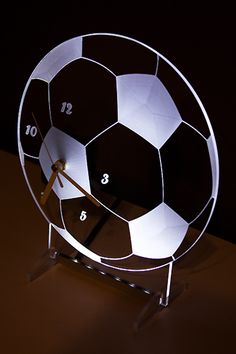 Clock with white backlight LED in the shape of a football. New design.