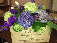 Centerpiece-Featuring-Hydrangeas-and-Purple-Stock-in-a-Wine-Box