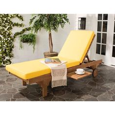 The built-in side table on this Newport-inspired Teak Outdoor Chaise | The Home Depot Reveals Its 15 Hottest Outdoor Decor Pieces for Summer | POPSUGAR Home Photo 9