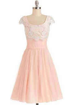 A feminine frock adorned with gorgeous lace, this pale pink dress would be perfect for a wedding, graduation, or any formal event!