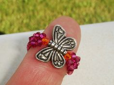 Super cute size 7 Butterfly Ring with Fuchsia and Sun crystals. #zibbet