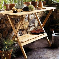 This, because sometimes you feel like working outside.  Simple Folding Potting Bench