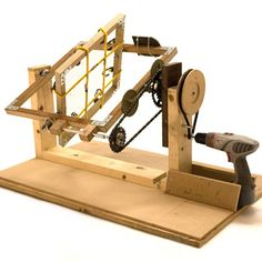 Rotational moulding machine made from scrap materials and powered by a cordless drill.