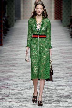 Love the silhouette of this dress - and the mix of details - athletic belt with lace, ruffle v-neck. Gucci's Front Row